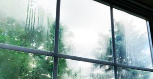 How do you get moisture out of double pane windows?